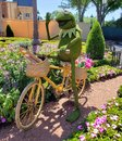 stock image of  Kermit topiary on a bike