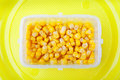 Kernel corn in a plastic container Stock Image