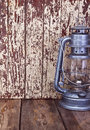 Kerosene lamp on the background of an old shabby wooden wall Royalty Free Stock Image