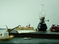 Kerosene lamp, hand scales with sugar and barberry. space for text Royalty Free Stock Photo