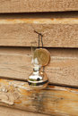 Kerosene lamp a on a wooden wall background texture background Stock Image