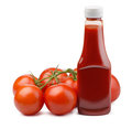 Ketchup bottle and fresh tomatoes isolated on white Stock Photos
