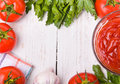 Ketchup frame and tomato on white wooden table Stock Images