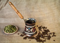 Kettle cofee and cardamom beans seeds Stock Photo