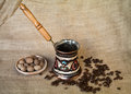 Kettle cofee and nutmeg beans Royalty Free Stock Photography