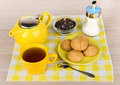 Kettle and cup of hot tea, sugar and biscuits Royalty Free Stock Photo