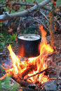 Kettle on tourist camp fire Royalty Free Stock Photo