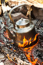 Kettle with water heated on the fire Royalty Free Stock Photo
