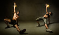 Kettleball excercise for two persons dark background Stock Image