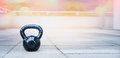 The kettlebell for outdoor sports stands the terrace of the house on Royalty Free Stock Photography