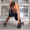 Kettlebells pull up crossfit training Royalty Free Stock Photo