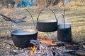 Kettles in the fire Royalty Free Stock Photo