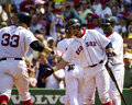 Kevin millar boston red sox right greets teammate jason varitek after hitting a homerun Stock Images