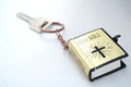 Key and bible a ring with Royalty Free Stock Photography