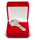 Key gift box on white Royalty Free Stock Photos