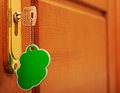 Key in keyhole with blank label Royalty Free Stock Photography