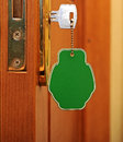 Key in keyhole with blank label Royalty Free Stock Image