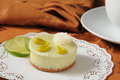 Key lime dessert tart a with coffee Stock Photos