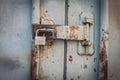 Key locker at rusty steel door Royalty Free Stock Photo