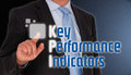 Key performance indicators body of businessman pressing button on interactive indicator screen Stock Images