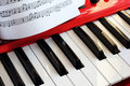 Key synthesizer and music sheet close up Stock Photography