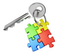 Key to maze concept solution problem and business success nickel door with keyring from four color puzzle pieces isolated on white Stock Image