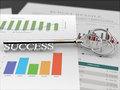 Key to success financial report black a silver with the word on a Royalty Free Stock Image