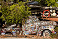 Key west florida old truck cover by stickers next to a bar in Stock Photography