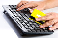 Keyboard and credit card online shopping businessman hands holding yellow typing desktop wireless computer for purchase Stock Images