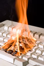 Keyboard on fire Stock Photos