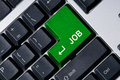 Keyboard with green key Job Stock Photos