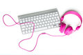 Keyboard and headphones on a desk Royalty Free Stock Photos