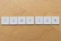 Keyboard letters temp job spell on desktop background Stock Image