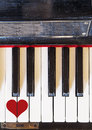Keyboard love music piano top view with a painted heart Stock Images