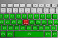 Keyboard with red spam email button surrounded with green email buttons Royalty Free Stock Photo