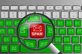 Keyboard with red spam email button surrounded with green email buttons and magnifying glass Royalty Free Stock Photo