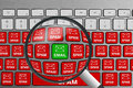 Keyboard with single green email button surrounded with red spam email buttons Royalty Free Stock Photo