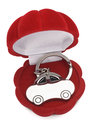 Keychain car in red gift box on white background Royalty Free Stock Photos