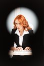 Keyhole view of young pretty business woman. Royalty Free Stock Photo