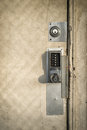 Keypad door lock on old wooden door an run down with multiple locks and a entry security Stock Image