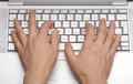 Keypad a laptop female hands printing on the Royalty Free Stock Photos