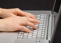 Keypad a laptop female hands printing on the Stock Image