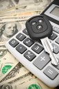 Keys from the car and calculator Royalty Free Stock Photo