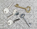 Keys of different types of puzzles on a close up of gold and silver Stock Images