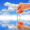Keys in hand over sky background Royalty Free Stock Photography