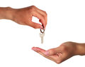Keys key hand hands business a handing over to another Royalty Free Stock Images