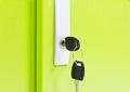 Keys lock on green door background Stock Photo