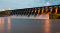 Keystone dam at dusk in oklahoma shot with all the gates open and flowing alot of water Stock Photography