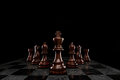 The khaki squad attack a of chess pieces leaded by king Royalty Free Stock Photo