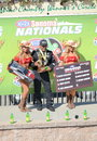 Khalid albalooshi wins top fuel dragster category at sonoma raceway and poses with wally trophy and traxxas girls Royalty Free Stock Photography